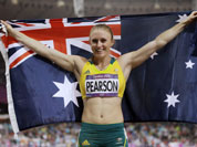 Australia`s Sally Pearson celebrates her gold medal win in the women`s 100-meter hurdles during the athletics in the Olympic Stadium at the 2012 Summer Olympics.