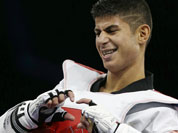 Sweden`s Uno Sanli reacts after his fight against Spain`s Joel Gonzalez Bonilla in men`s 58-kg taekwondo competition at the 2012 Summer Olympics.