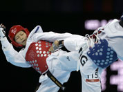 Papua New Guinea`s Theresa Tona fights Japan`s Erika Kasahara (in red) during their match in women`s 49-kg taekwondo competition at the 2012 Summer Olympics.