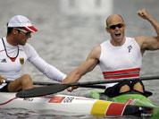 Norway`s Eirik Veras Larsen, right, celebrates after winning the gold medal in the men`s kayak single 1000m in Eton Dorney, near Windsor, England, at the 2012 Summer Olympics.