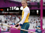 Australia`s Steven Hooker warms up for his first attempt in the men`s pole vault during the athletics in the Olympic Stadium at the 2012 Summer Olympics.