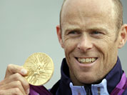 Norway`s Eirik Veras Larsen displays the gold medal he won in the men`s kayak single 1000m in Eton Dorney, near Windsor, England, at the 2012 Summer Olympics.