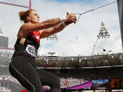 Germany`s Betty Heidler takes a throw in a women`s hammer throw qualification round during the athletics in the Olympic Stadium at the 2012 Summer Olympics.