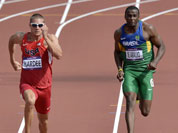 United States` Trey Hardee, Brazil`s Luiz Alberto De Araujo and United States` Ashton Eaton compete in a men`s decathlon 100-meter heat during the athletics in the Olympic Stadium at the 2012 Summer Olympics.