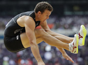 New Zealand`s Brent Newdick competes in a decathlon long jump during the athletics in the Olympic Stadium at the 2012 Summer Olympics, London.
