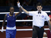 Great Britain`s Nicola Adams, and India`s Chungneijang Mery Kom Hmangte react following a women`s flyweight 51-kg semifinal boxing match at the 2012 Summer Olympics in London. 