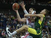 Russia`s Timofey Mozgov, drives to the basket past Lithuania`s Renaldas Seibutis during a men`s quarterfinals basketball game at the 2012 Summer Olympics in London.