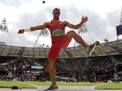 United States` Ashton Eaton reacts after his throw in the shot put in the decathlon during the athletics in the Olympic Stadium at the 2012 Summer Olympics, London.