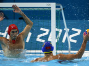 Goalkeeper Inaki Aguilar Vicente, of Spain defends against Drasko Brguljan of Montenegro during a men`s quarterfinal water polo match at the 2012 Summer Olympics, in London.