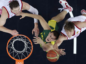 Russia`s Andrei Kirilenko, and Timofey Mozgov, battle Lithuania`s Paulius Jankunas, for a rebound during a men`s quarterfinals basketball game at the 2012 Summer Olympics in London.