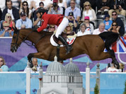 Steve Guerdat, of Switzerland, rides Nino des Buissonnets, in the equestrian show jumping individual competition, at the 2012 Summer Olympics in London.