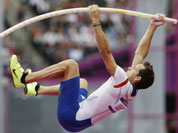 France`s Renaud Lavillenie competes in a men`s pole vault qualification round during the athletics in the Olympic Stadium at the 2012 Summer Olympics in London