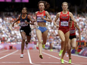 United States` Alice Schmidt leads Russia`s Mariya Savinova and India`s Tintu Luka across the finish line in a women`s 800m heat during the athletics in the Olympic Stadium at the 2012 Summer Olympics in London
