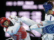 Chinese Taipei`s Li-Cheng Tseng fights Thailand`s Rangsiya Nisaisom (in red) during their match in women`s 57-kg taekwondo competition at the 2012 Summer Olympics in London.
