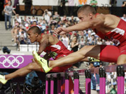 United States` Ashton Eaton, and United States` Trey Hardee compete in a 110-meter hurdles heat in the decathlon during the athletics in the Olympic Stadium at the 2012 Summer Olympics, London.