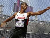Canada`s Damian Warner takes a throw in the discus throw for the decathlon during the athletics in the Olympic Stadium at the 2012 Summer Olympics, London.