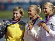 Winners of the women`s kayak single 500m pose on the podium in Eton Dorney, near Windsor, England, at the 2012 Summer Olympics. From left to right, Ukraine`s Inna Osypenko-Radomska, silver medal, Hungary`s Danula Kozak, gold medal and South Africa`s Bridgitte Hartley, bronze.