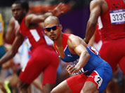 Dominican Republic`s Felix Sanchez waits for the baton during a men`s 4x400-meter relay heat during the athletics in the Olympic Stadium at the 2012 Summer Olympics, London.