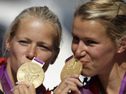 Germany`s Frnaziska Weber, and Tina Dietze pose with the gold medals then won in the women`s kayak double 500m in Eton Dorney, near Windsor, England, at the 2012 Summer Olympics.
