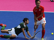 Pakistan`s Muhammad Rizwan Jr, and South Korea`s Yoon Sung-hoon vie for the ball in their hockey classification match at the 2012 Summer Olympics in London.