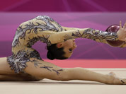 Egypt`s Yasmine Mohmed Rostom performs during the rhythmic gymnastics individual all-around qualifications at at the 2012 Summer Olympics in London.