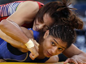 Um Jieun of South Korea competes against Marwa Amri of Tunisia (in blue) during a 55-kg women`s freestyle wrestling competition at the 2012 Summer Olympics, in London.