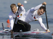 Germany`s Peter Kretschmer and Kurt Kuschela paddle on their way to winning the gold medal men`s kayak double 1000m in Eton Dorney, near Windsor, England, at the 2012 Summer Olympics.