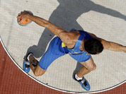 The Ukraine`s Oleksiy Kasyanov competes in the men`s decathlon discus throw event at the London 2012 Olympic Games at the Olympic Stadium, in London.
