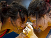Canada`s Tonya Verbeek, goes head to head with India`s Geeta Geeta during a 55-kg women`s freestyle wrestling competition at the 2012 Summer Olympics, in London.
