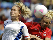 France`s Eugenie Le Sommer, heads the ball against Canada`s Lauren Sesselmann, right, during their women`s bronze medal soccer match at the 2012 London Summer Olympics, in Coventry, England.