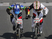 Cyclists compete in a BMX cycling men`s quarterfinal run during the 2012 Summer Olympics in London.