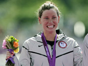 Silver medalist Haley Anderson of the United States reacts during a medals ceremony after the women`s 10-kilometer marathon swimming competition at Hyde Park at the 2012 Summer Olympics, in London.
