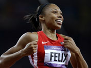 United States` Allyson Felix celebrates her win in the women`s 200-meter final during the athletics in the Olympic Stadium at the 2012 Summer Olympics.