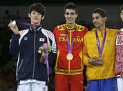 Gold medalist Spain`s Joel Gonzalez Bonilla,  stands on the podium with silver medalist South Korea`s Lee Dae-hoon, bronze medalist Colombia`s Oscar Munoz Oviedo and bronze medalist Russia`s Alexey Denisenko, during the medal ceremony for the men`s 58-kg taekwondo competition.