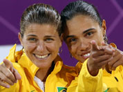 Brazil`s Larissa Franca and Juliana Silva, right, react to the fans during the women`s medal ceremonies at the 2012 Summer Olympics.