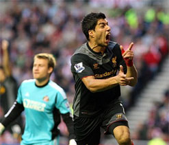 Suarez saves point for Liverpool in 1-1 draw at Sunderland