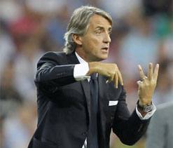 Arsenal are title contenders despite loss of Robin van Persie, insists Mancini