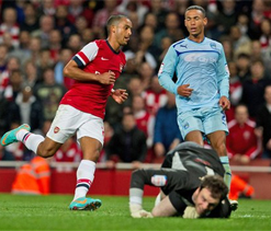 Theo Walcott scores double in Arsenal's 6-1 victory against Coventry