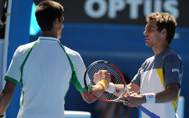 Australian Open 2013: Novak Djokovic starts title defence with routine win