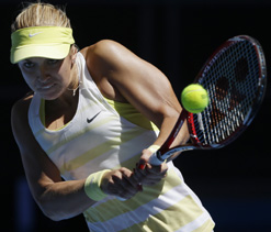 Caroline Wozniacki fights back to beat Lisicki