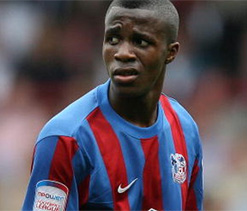 Arsenal and Man United fight it out for Wilfried Zaha