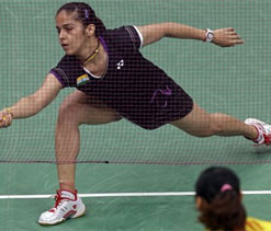 Saina sails to quarters, injured Kashyap crashes out