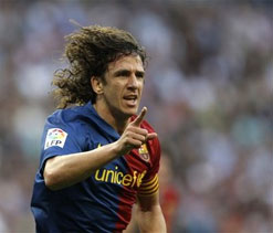 Carles Puyol signs Barcelona contract extension until 2016