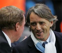 Redknapp says Mancini deserves medal for handling too many egos at Man City