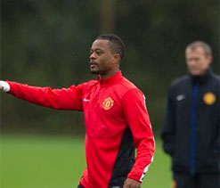 Alex Ferguson defends under-fire Patrice Evra