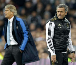Ex-Real coaches Jose Mourinho and Manuel Pellegrini meet