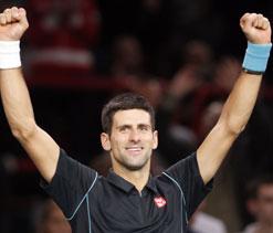 No mask needed as daunting Djokovic beats Isner
