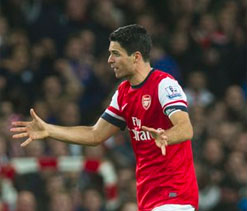 Arsenal sink Liverpool to stake title claim