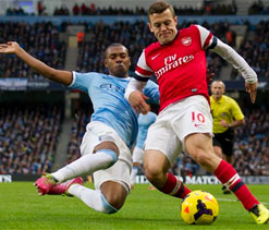 Wilshere accepts FA charge over offensive hand gesture to City fans