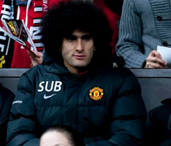 Fellaini faces long Manchester United absence after wrist surgery